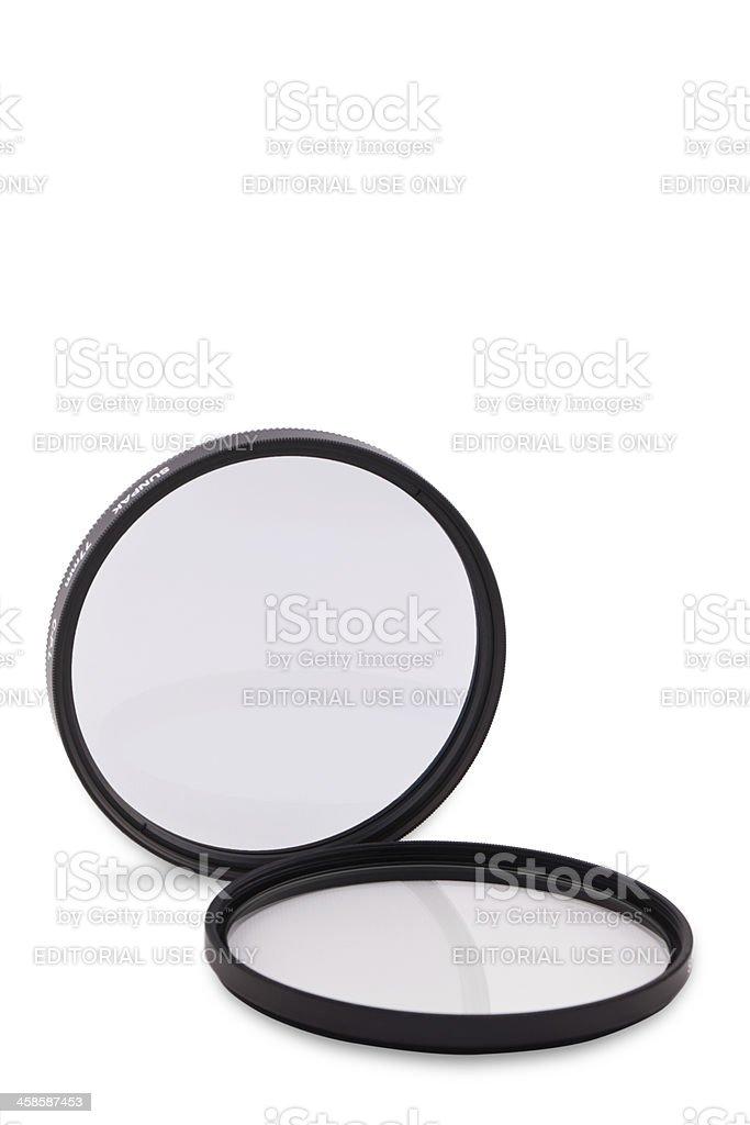77mm Sunpak camera lens filter stock photo