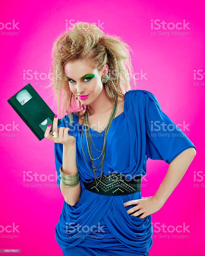 80s beautiful woman with video tape stock photo