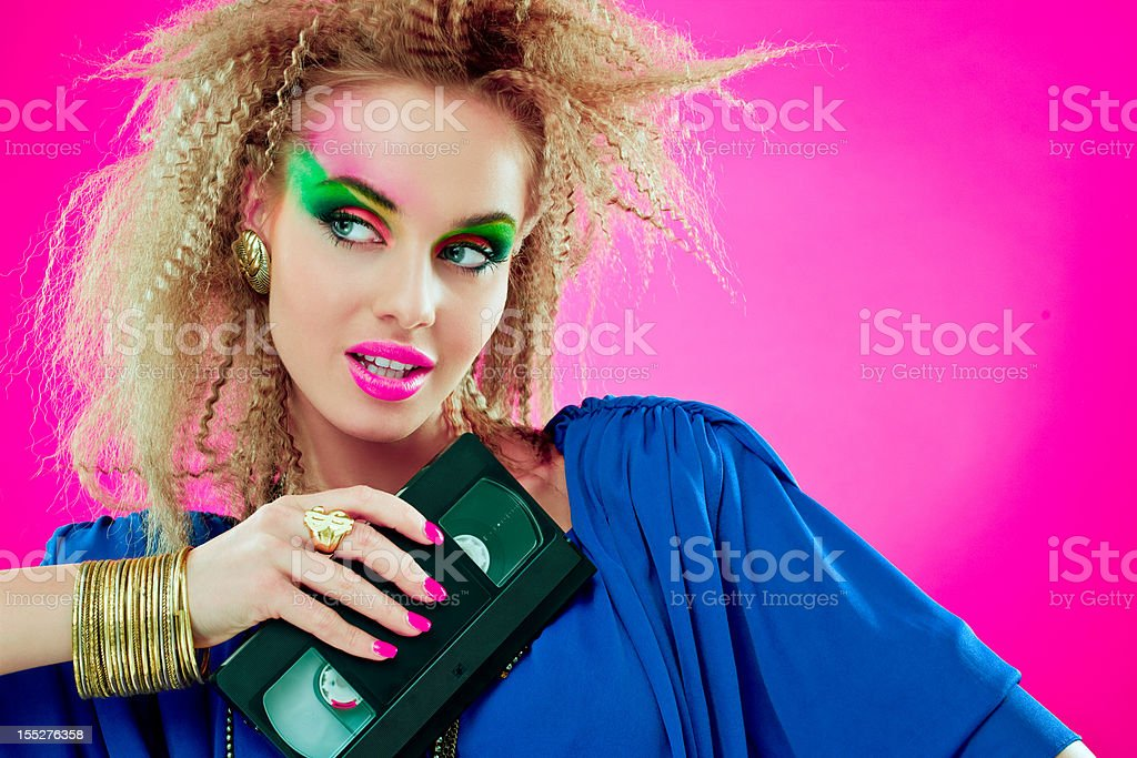 80s beautiful woman with video tape royalty-free stock photo