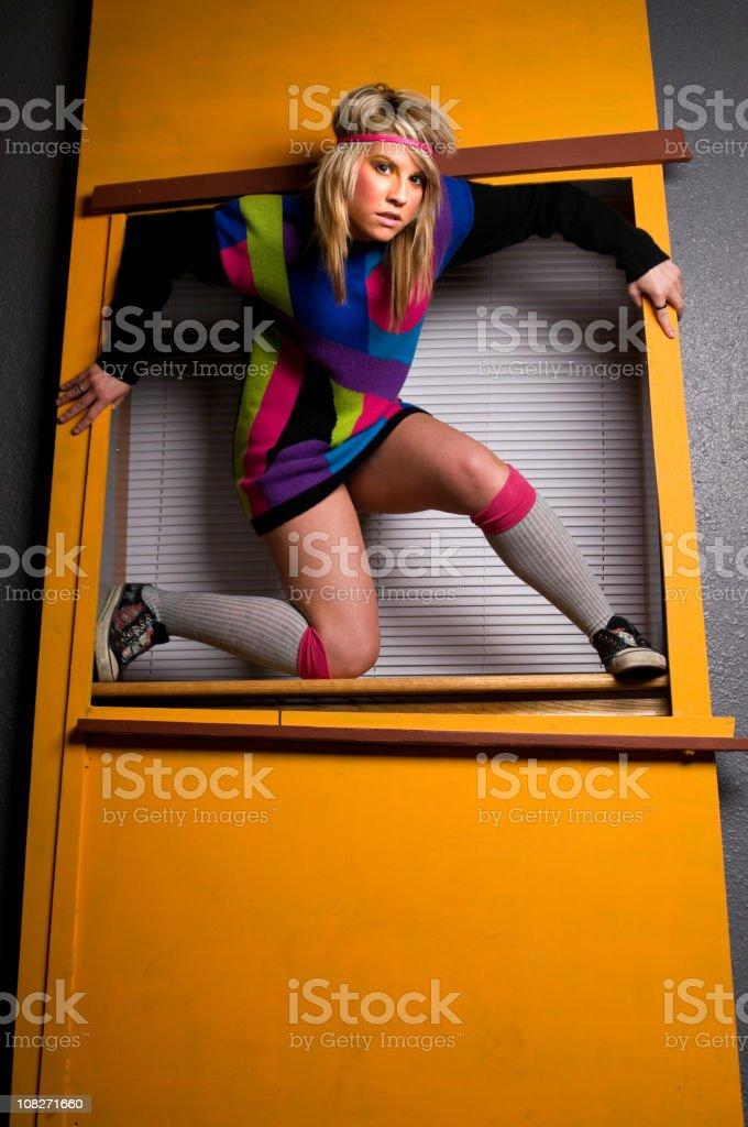 80s Style Funky Emo Girl Posing in Window stock photo