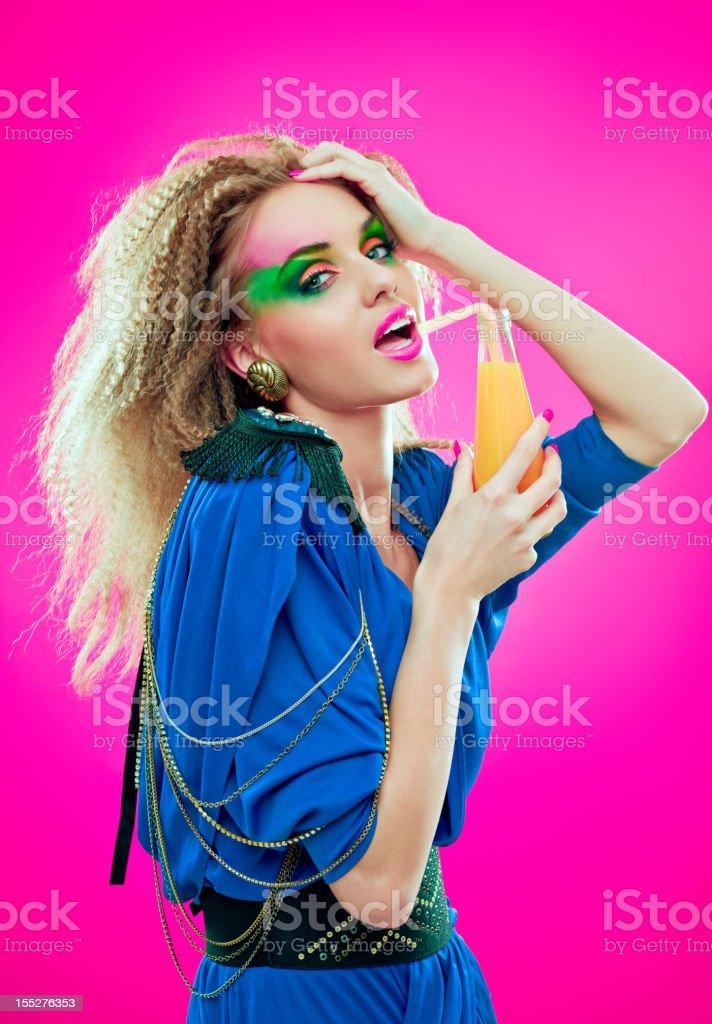 80s style girl with orange juice royalty-free stock photo