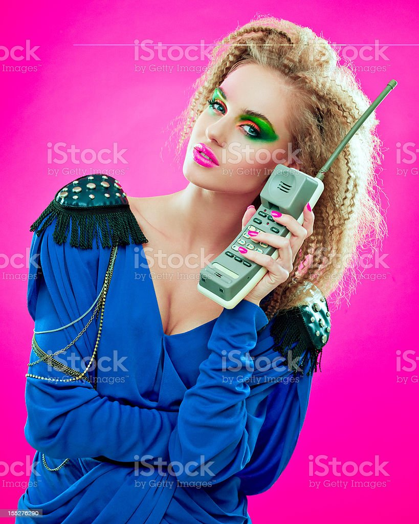80s style girl with vintage phone stock photo