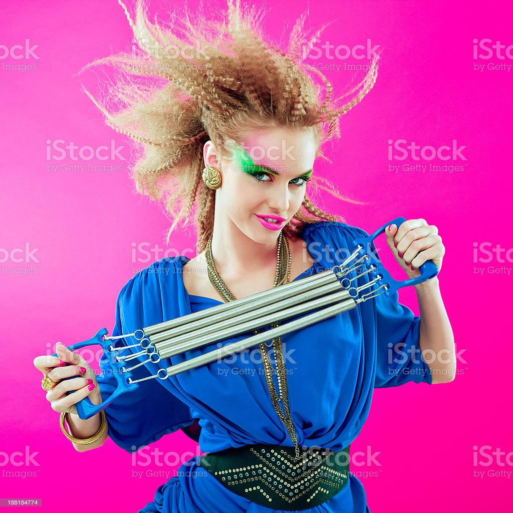 80s style woman with expander stock photo