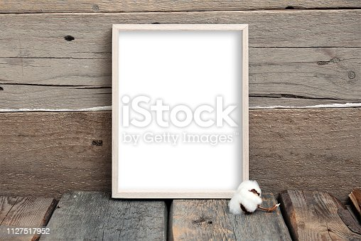 istock 8x10 vertical thin box frame mockup on a wooden background 1127517952