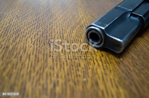 istock 9mm gun on the table 841632328