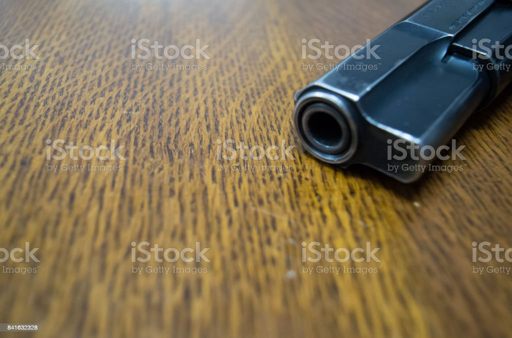 9mm gun on the table stock photo