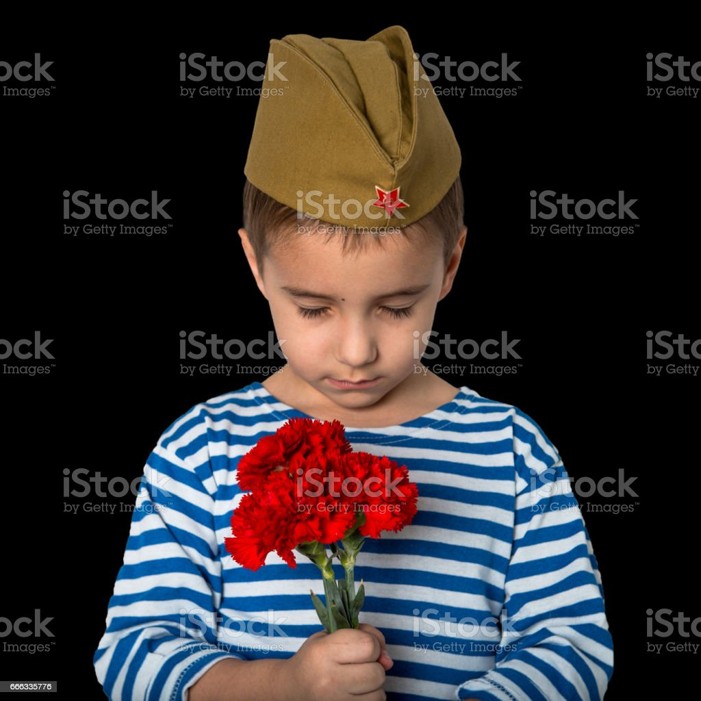 9th May. Victory Day. A little boy mourns about the fallen soldiers stock photo