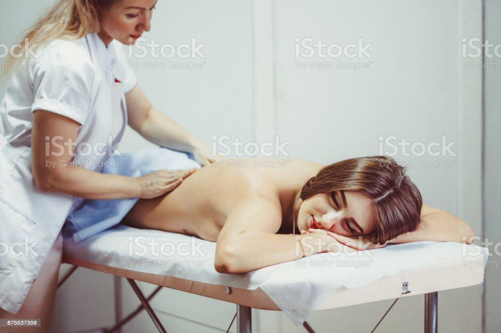 a back massage in the salon stock photo