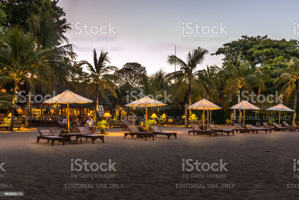 a balinese beach at night with yellow glowing umbrellas - Royalty-free Asia Stock Photo