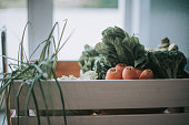 a basket of fruits and vegetable in the kitchen