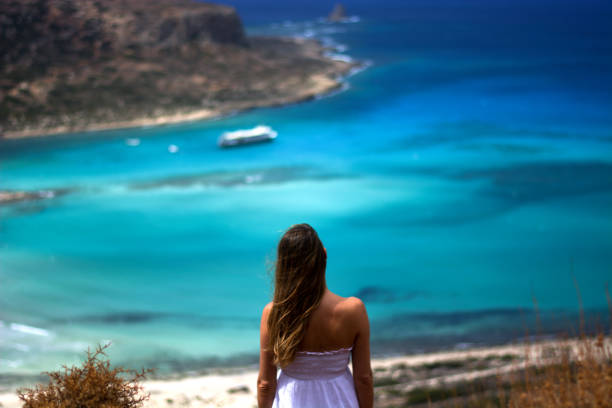 a beautiful girl observes the crystal clear sea