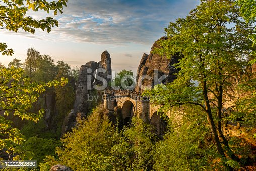 a beautiful view of the bridge of the Bastei of Rathen in saxon switzerland while the sun is rising, Germany