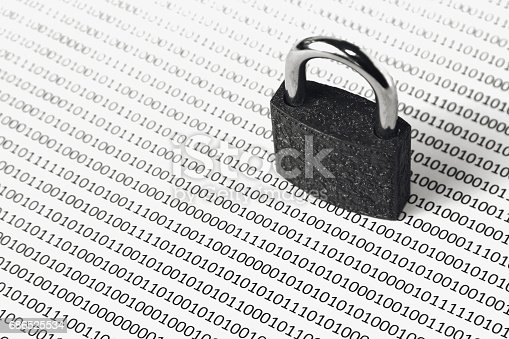 686526046istockphoto a black and white concept image that can be used to represent cyber security or the protection of software code. This image has selective focusing on the padlock 686525534