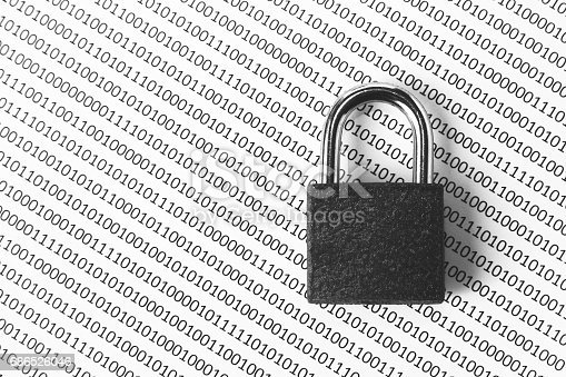 istock a black and white concept image that can be used to represent cyber security or the protection of software code. This image has selective focusing on the padlock 686526046