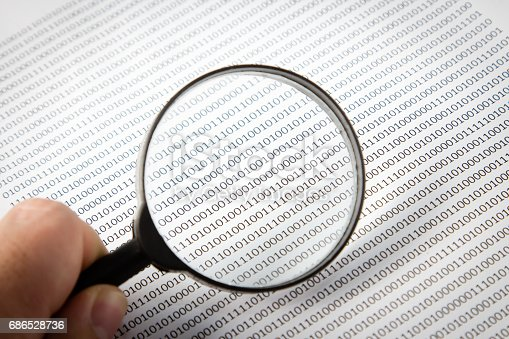 686526046istockphoto a black and white image of a human scrutinizing software code, this image can be used to represent the function of an antivirus program on a computer. 686528736