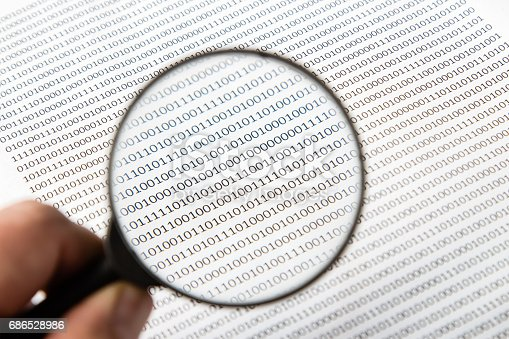 686526046istockphoto a black and white image of a human scrutinizing software code, this image can be used to represent the function of an antivirus program on a computer. 686528986