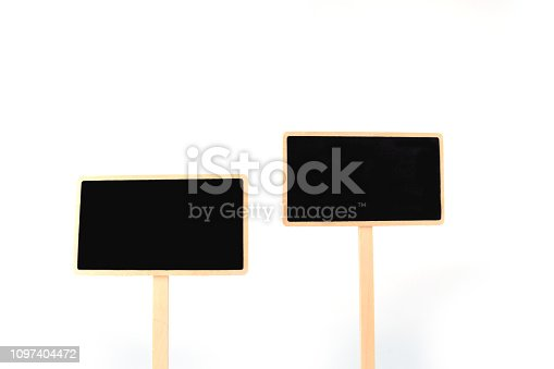 923869178 istock photo a blank blackboard label isolated on a white background 1097404472
