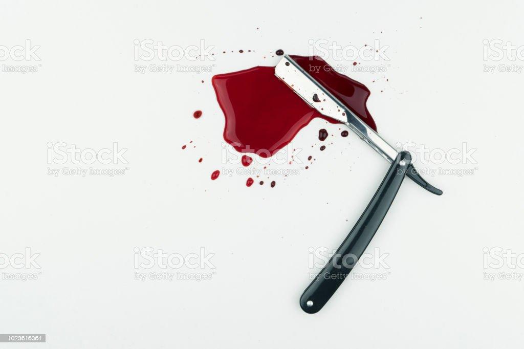 a bloody vintage straight razor stock photo