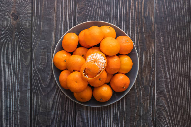 a blow of ripe orange tangerines shot from above stock photo