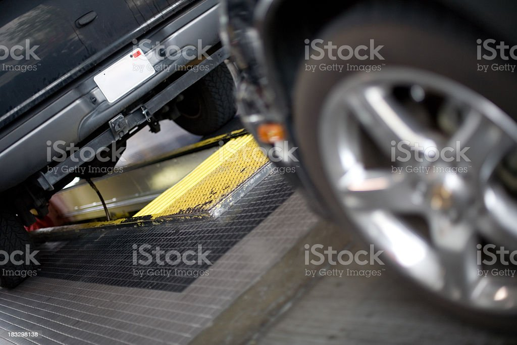 a bottom view of an oil change of a car. royalty-free stock photo