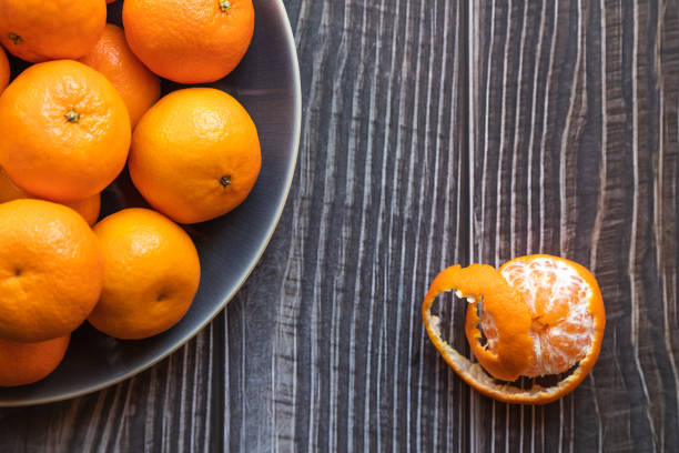 a bowl of ripe orange tangerines shot from above stock photo
