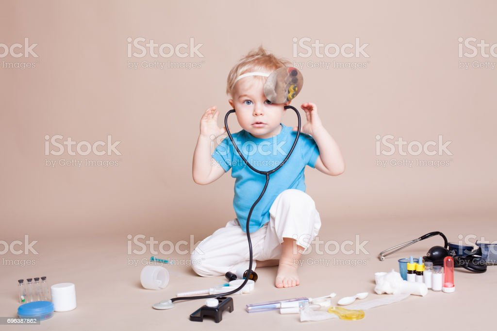 a boy plays in doctor medicine hospital stock photo
