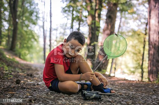 photos of a boy with binoculars and a net