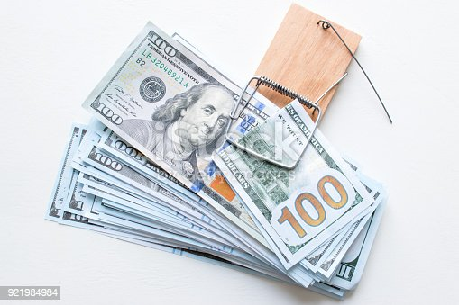 848170878istockphoto a bribe in a mouse trap. fight against corruption 921984984