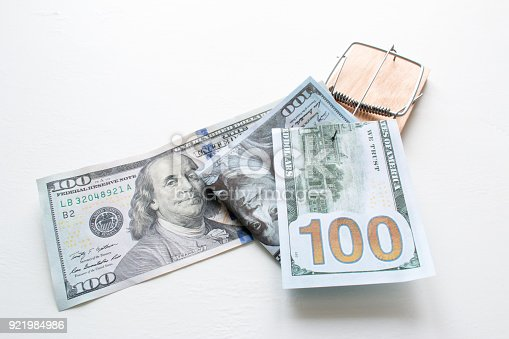 848170878istockphoto a bribe in a trap on a white background 921984986