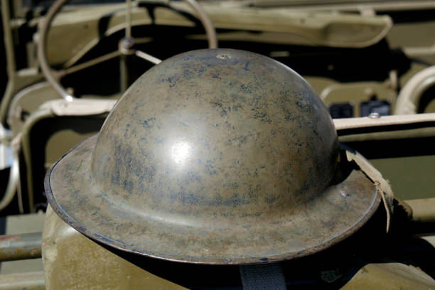 a british helmet of World War II on the jeep a british helmet of World War II on the jeep dieppe france stock pictures, royalty-free photos & images