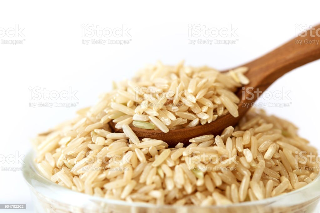 a brown rice on white background , healthy food royalty-free stock photo