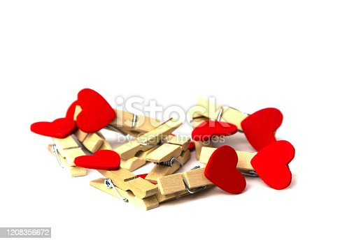 istock a bunch of clothespins with hearts on a white background 1208356672