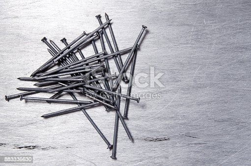 istock a bunch of metal nails on the alluminium scratched background 883336630