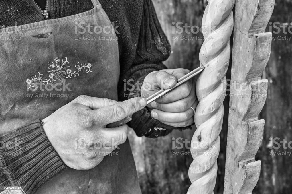 a carpenter digs a wooden column stock photo
