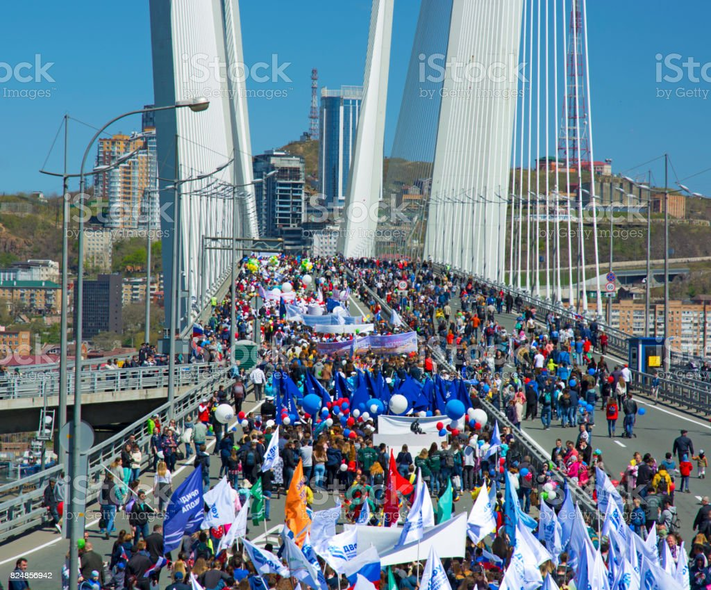 a celebratory parade in honor of the first Maya. people walk on the bridge stock photo