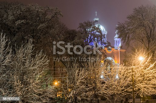 istock a church among the trees covered with snow 887930052