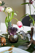istock a close up of a jungle-themed table setting with a toy zebra and lion among the flower decorations 1296147186