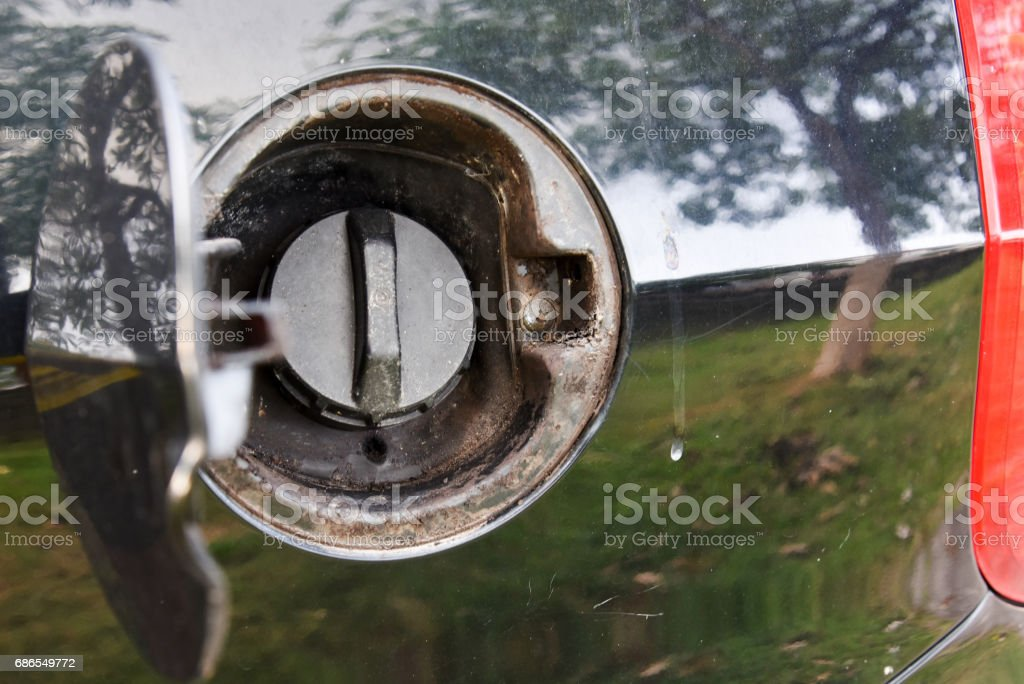 a closed car gas cap stock photo