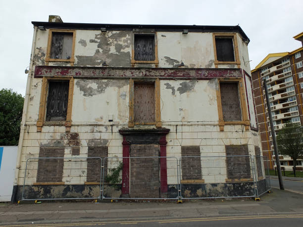 a collapsing fenced off derelict abandoned pub building in wakefield england the front of a collapsing fenced off derelict abandoned pub building in wakefield england awaiting demolition derelict stock pictures, royalty-free photos & images