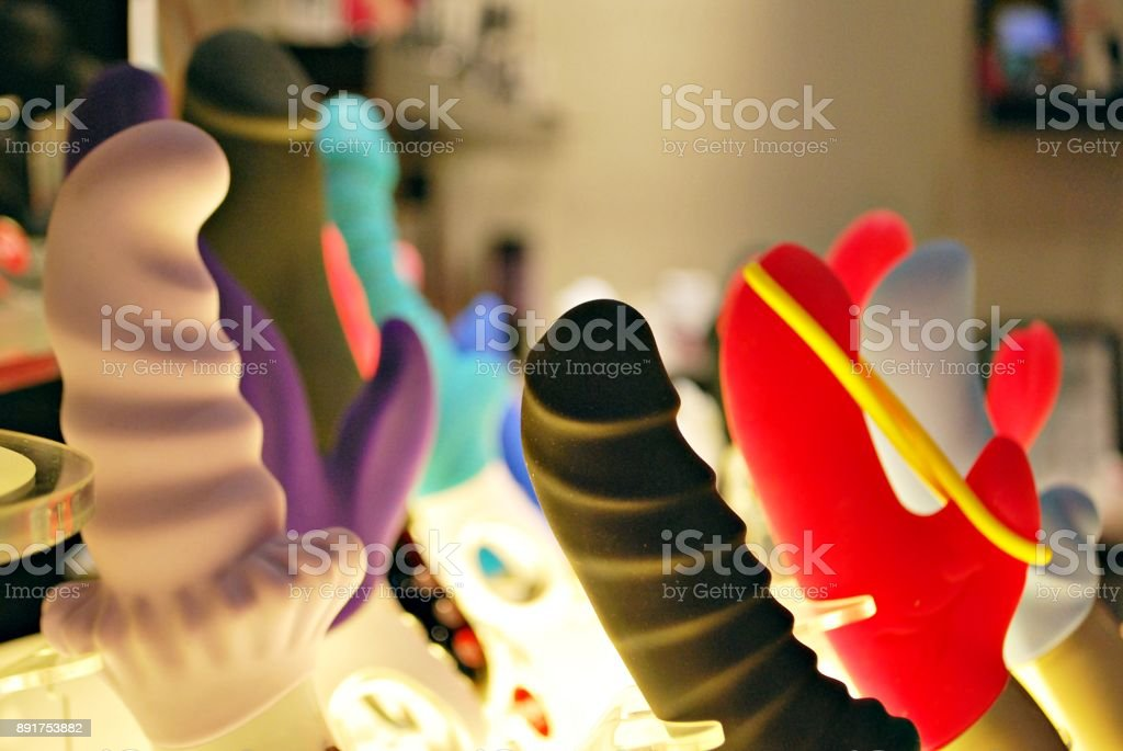 a collection of different types of sextoys, including dildo, vibrators and butt plugs stock photo