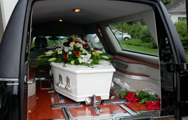 a colorful casket in a hearse or chapel before funeral or burial at cemetery - funerale foto e immagini stock