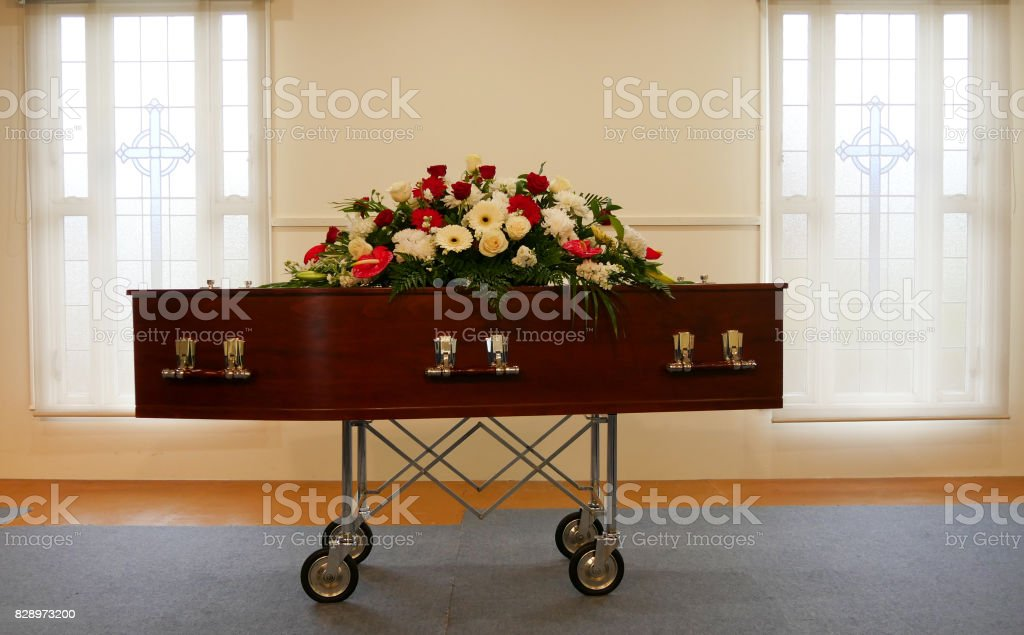 a colorful casket in a hearse or chapel before funeral or burial at cemetery stock photo