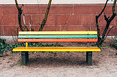 istock a colorful wooden bench with raindrops 1301759955