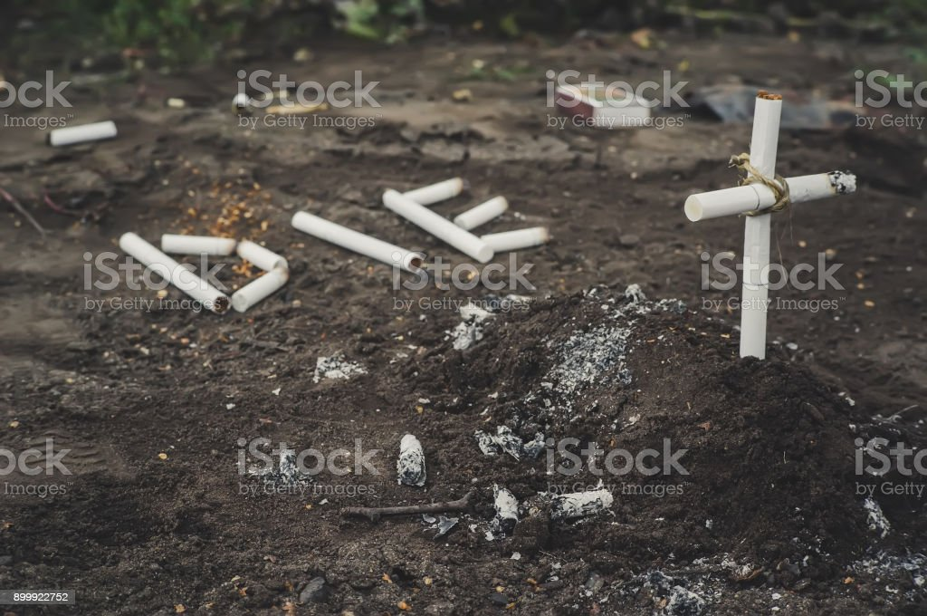 a cross from butts. stock photo