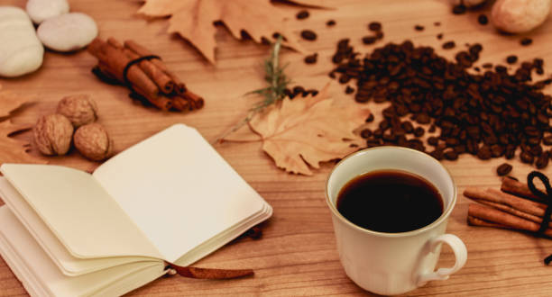 a cup of coffee and small notebook, stock photo