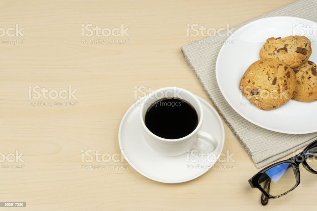 a cup of coffee, three pieces of chocolate chip cookies - Royalty-free Baked Stock Photo