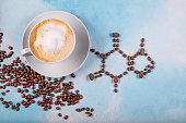 istock a cup of coffee with caffeine molecule created by coffee beans. 1223505749