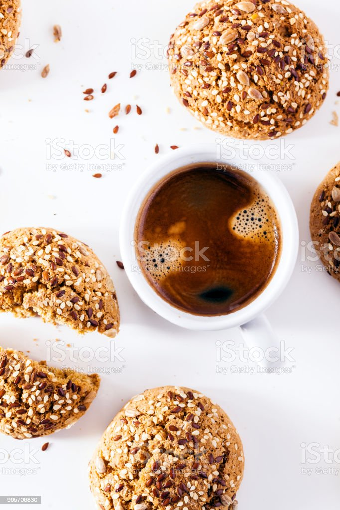 a cup of espresso and fresh biscuits on a white background. a fr stock photo