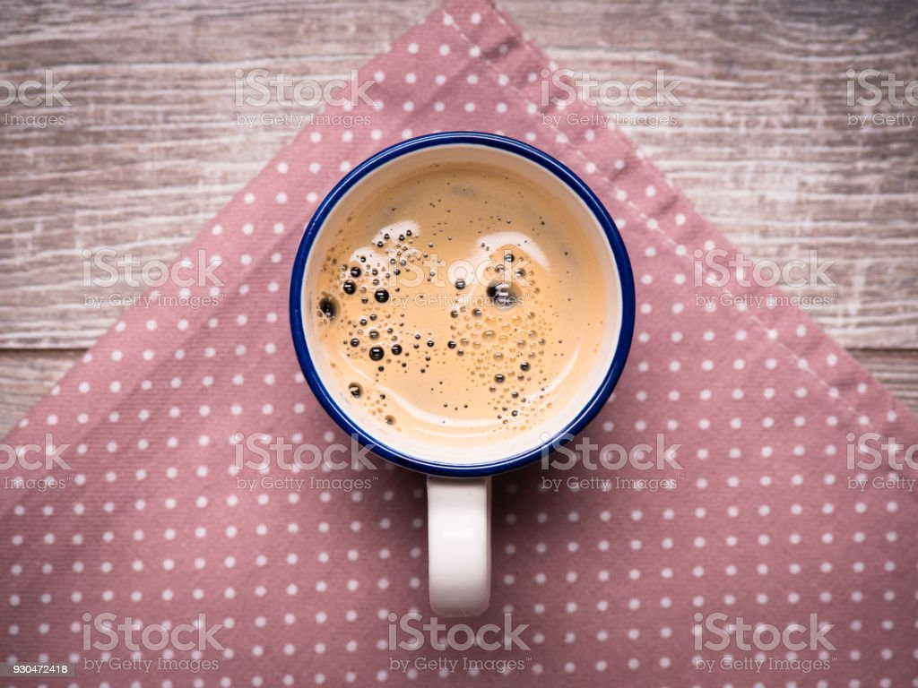 a cup of freshly prepared coffee on the table stock photo