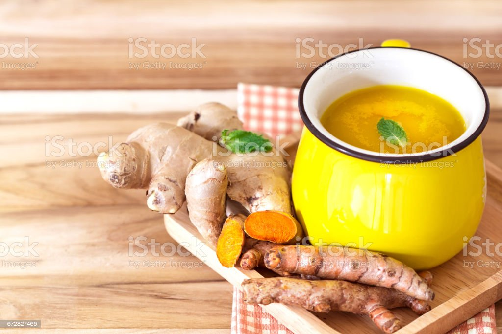 a cup of Turmeric Tea with lemon and ginger stock photo